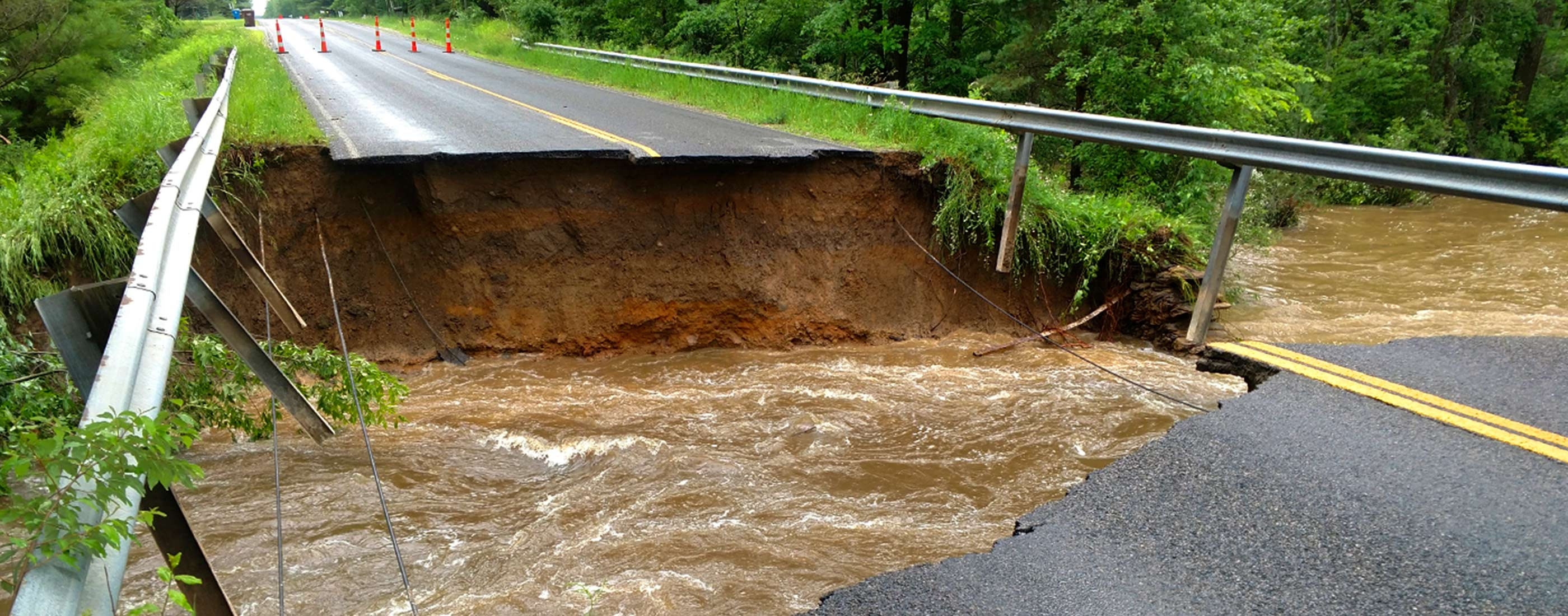 Extensive roadway damage in Midland County, Michigan after flooding.