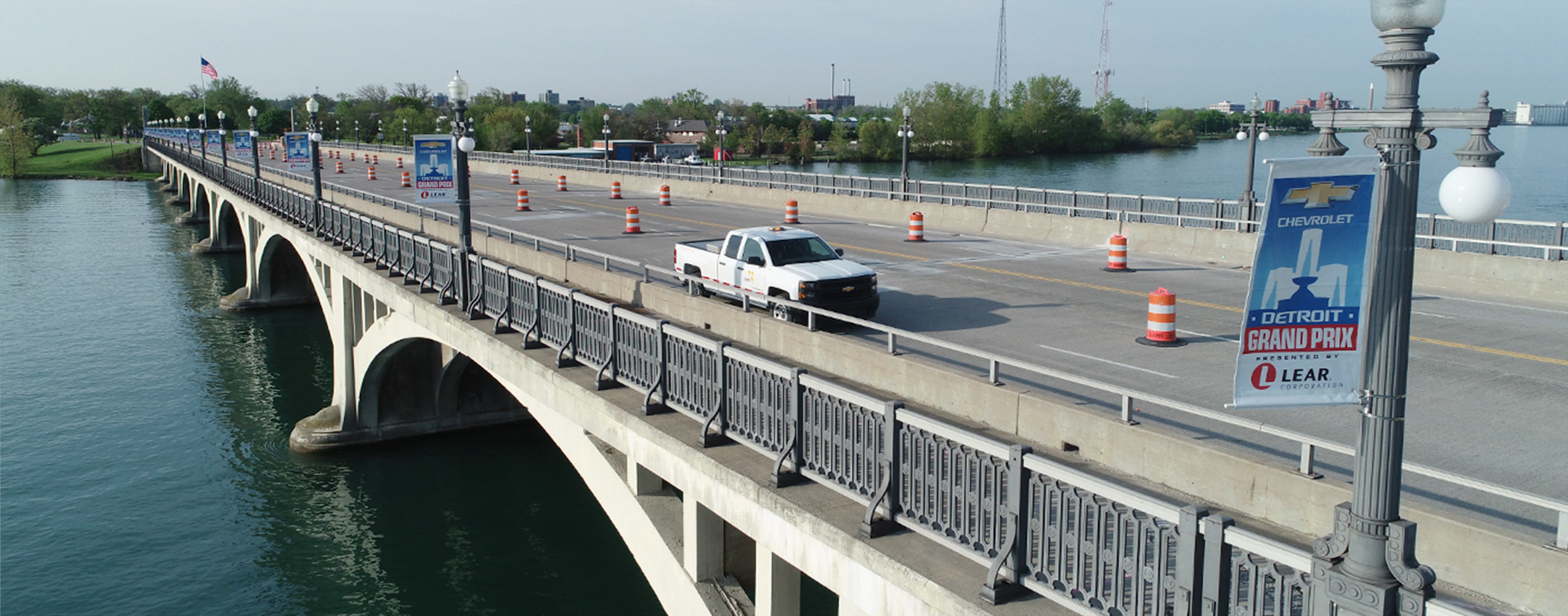 An OHM Advisors truck parked on the Douglas A. MacArthur Bridge during preservation.