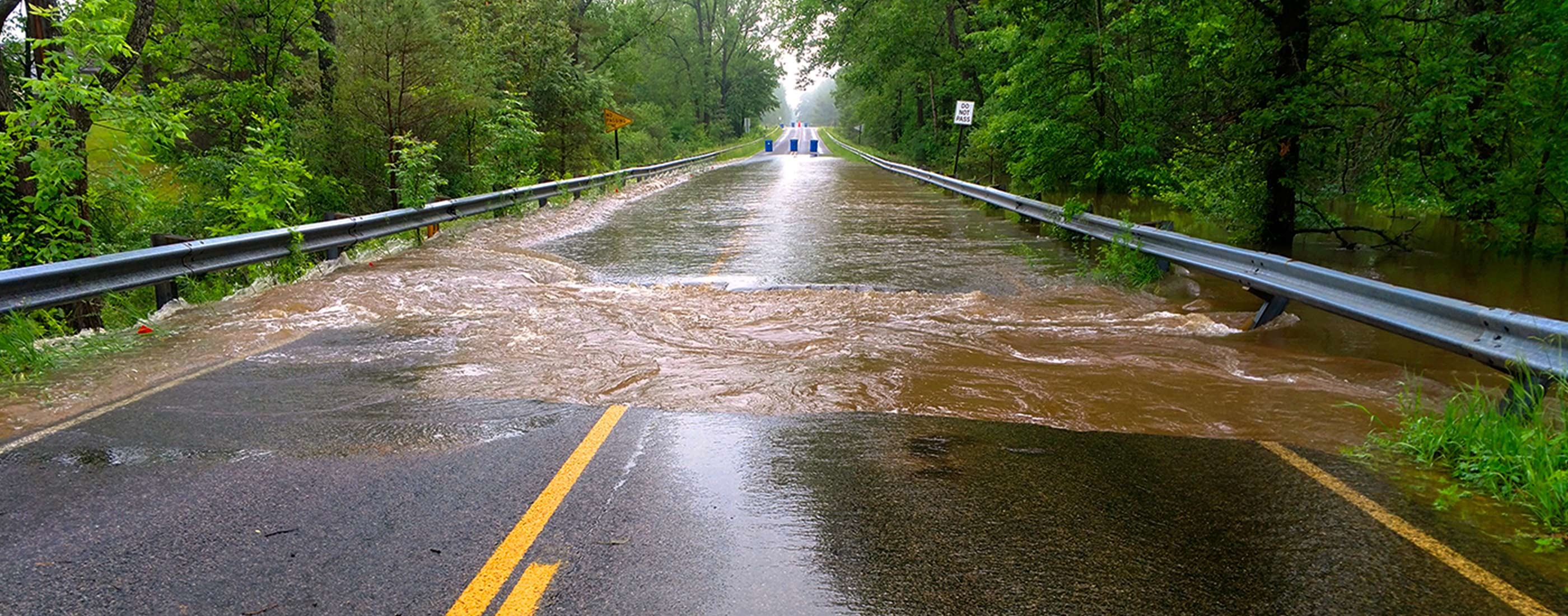Rainfall and high water flooded and damaged Midland County roads.