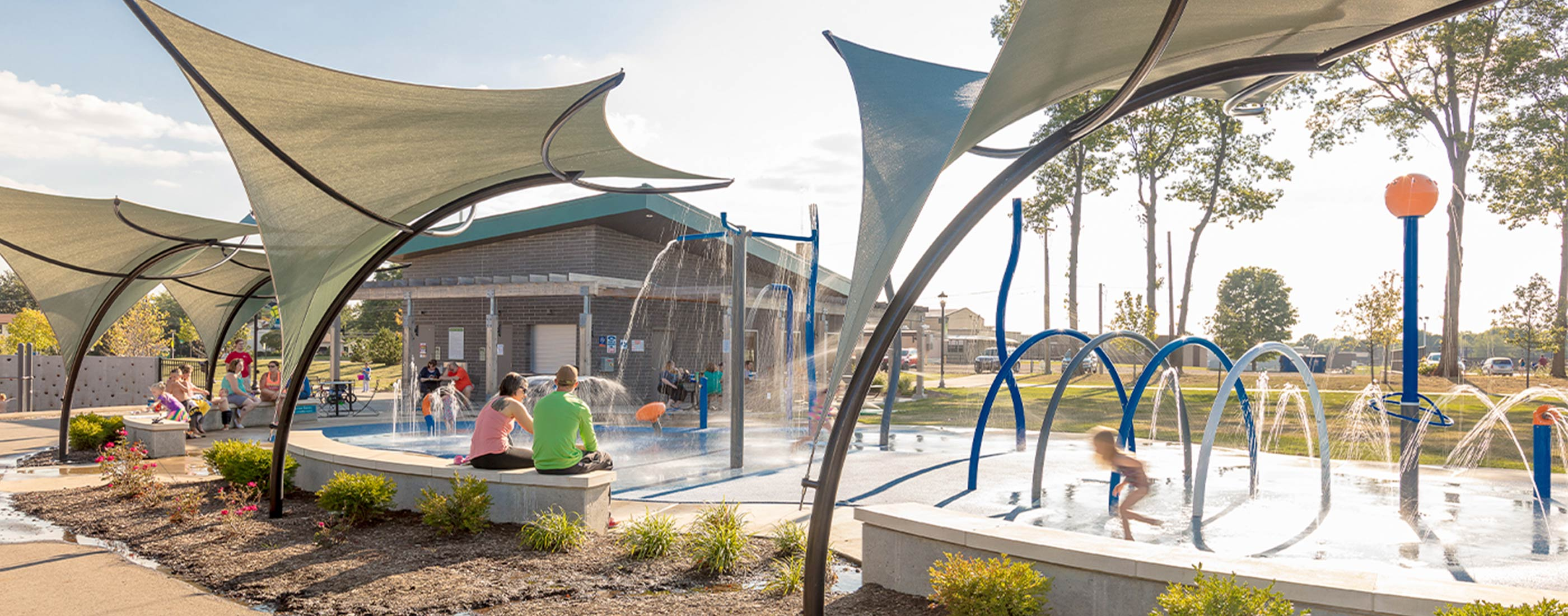 The City of Green Central Park includes a splash pad with multiple play zones.