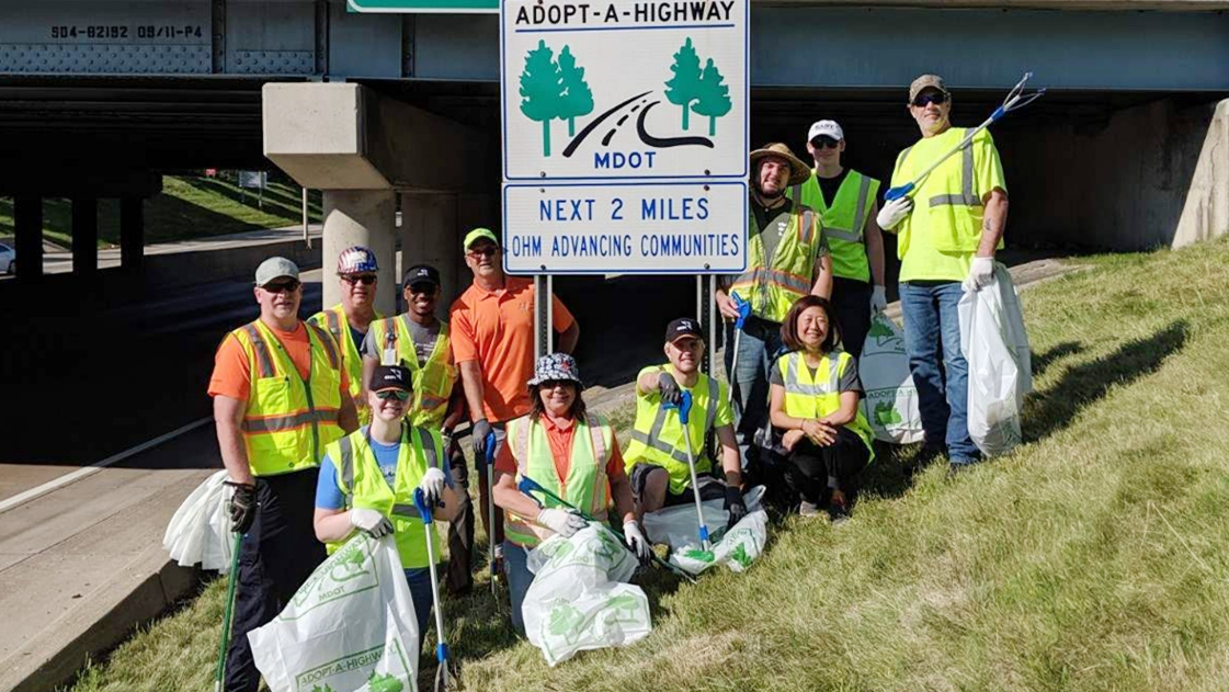 A team of OHM Advisors employees volunteer with Adopt-A-Highway.