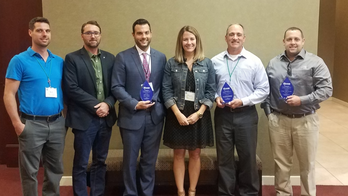 OHM Advisors employees accept the 2018 Great Lakes Region of the American Society of Highway Engineers Award