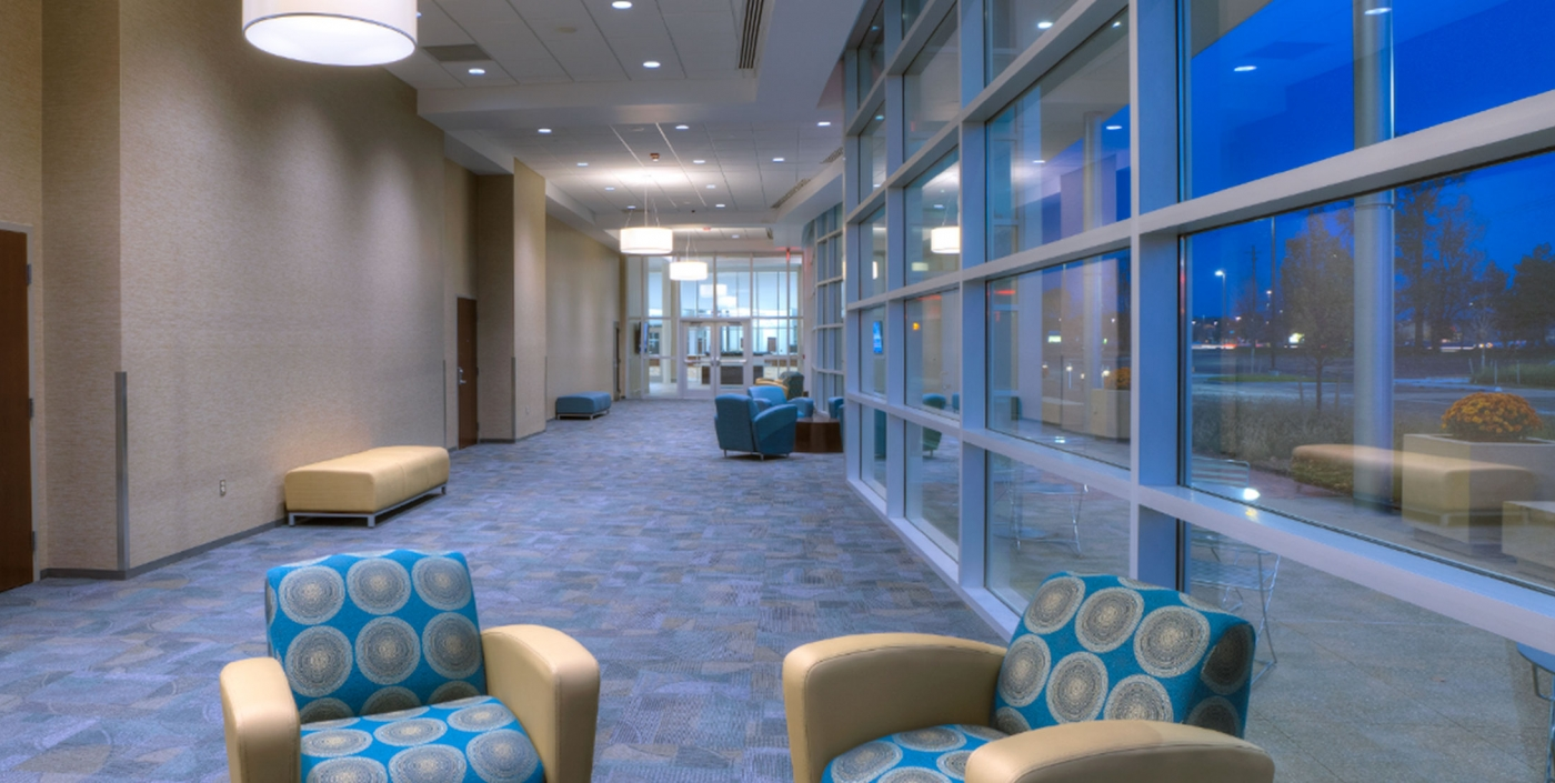 A modern and vibrant design in lobby welcomes citizens into Westland, Michigan's City Hall, designed by OHM Advisors.