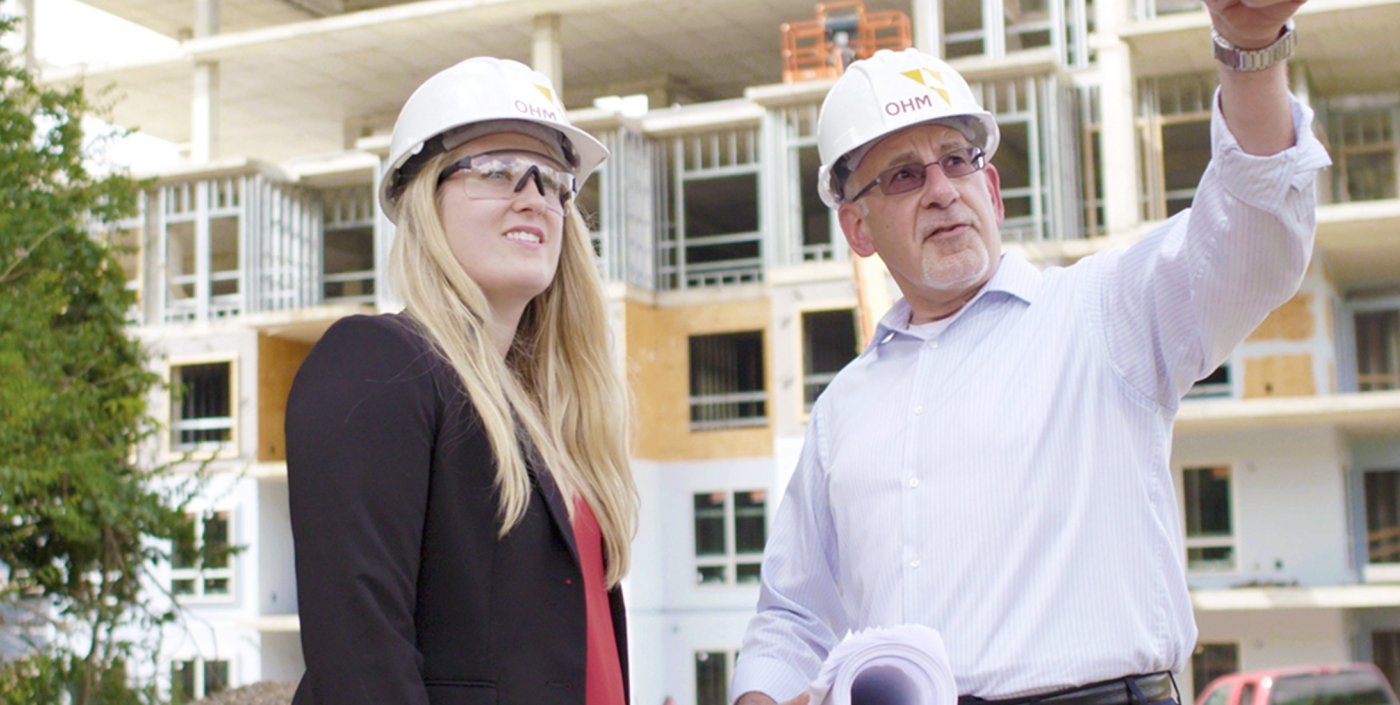 OHM Advisors' architects visit a construction site.
