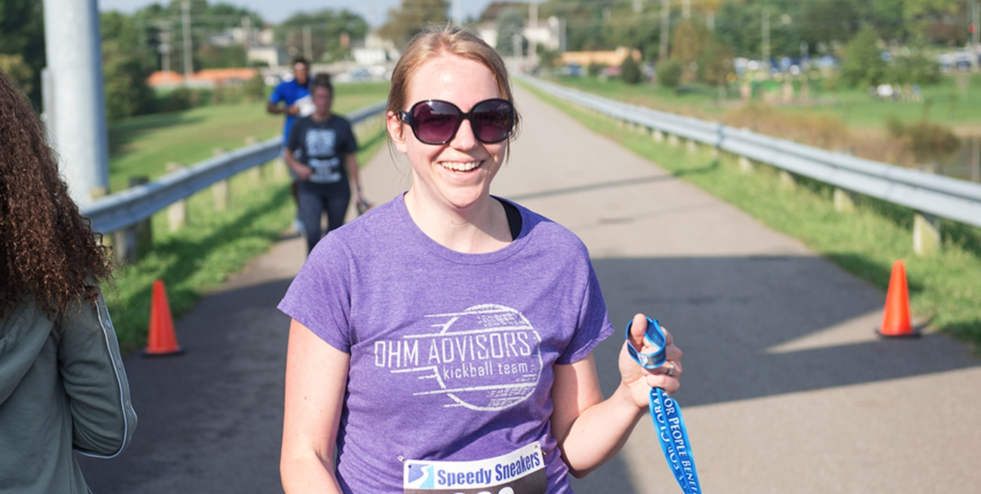 OHM Advisors employee participates in a Relay Race.