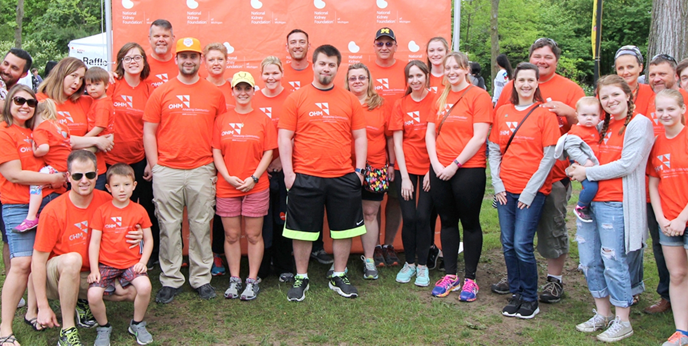 OHM Advisors employees gather together for a walk in support of the National Kidney Foundation.
