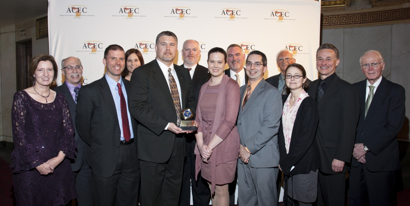 Leaders of OHM Advisors receive an ACEC award in 2013.