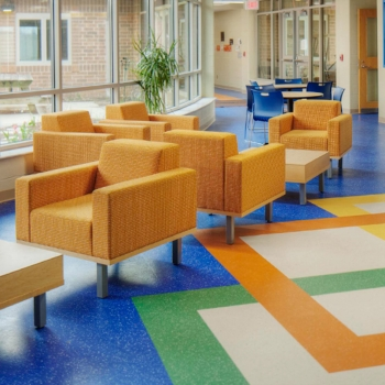 Shared learning spaces and bright colors create a flexible learning environment in West Liberty-Salem Local School District's campus, designed by OHM Advisors.