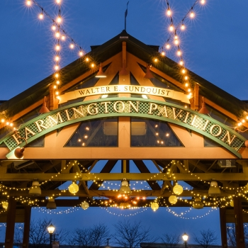 Downtown Farmington's Pavilion lit up at night.