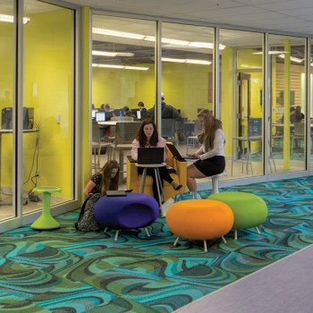 Small classrooms, reconfigurable furniture, and bright colors create a flexible learning environment at Marysville's STEM High School, designed by OHM Advisors.