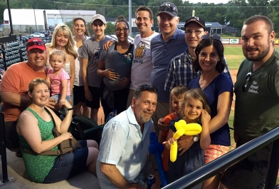 Employees from OHM Advisors gather for a Utica baseball outing.