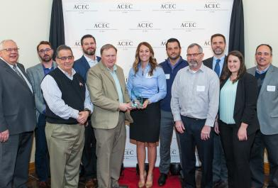 OHM Advisors' employees accept the American Council of Engineering Companies of Ohio Arcadis Award recognizing the Downtown Newark, Ohio Revitalization Project
