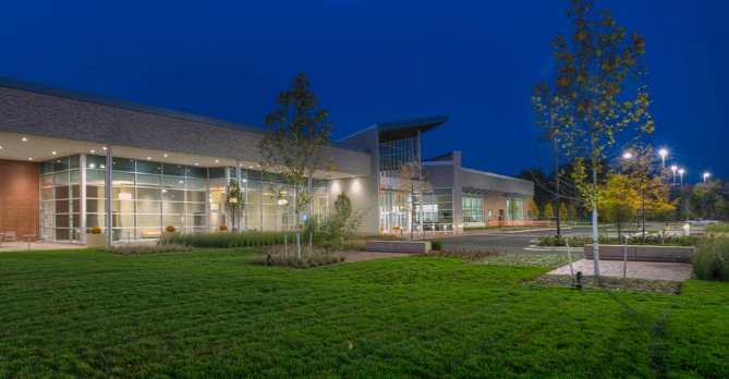 At Westland, Michigan's City Hall, designed by OHM Advisors, a large entrance canopy connects the building to the new, extensive outdoor green space.