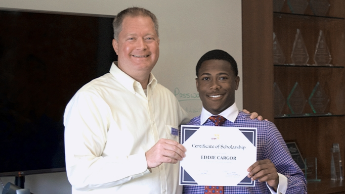 OHM Advisors principal presents Diversity Scholarship Award.