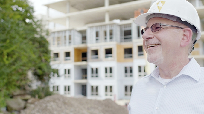 An architect visits construction site of mixed-use campus designed by OHM Advisors.