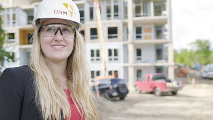 An intern on a job site during construction gets hands-on experience.